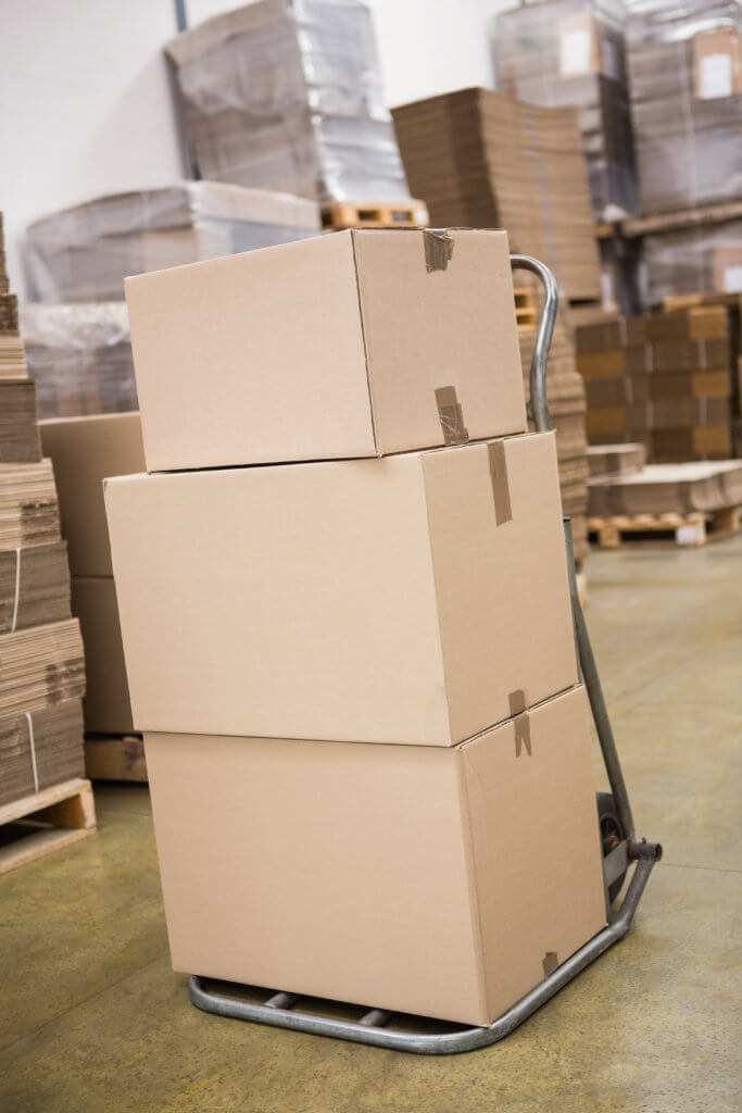 Boxes on trolley in a storage facility