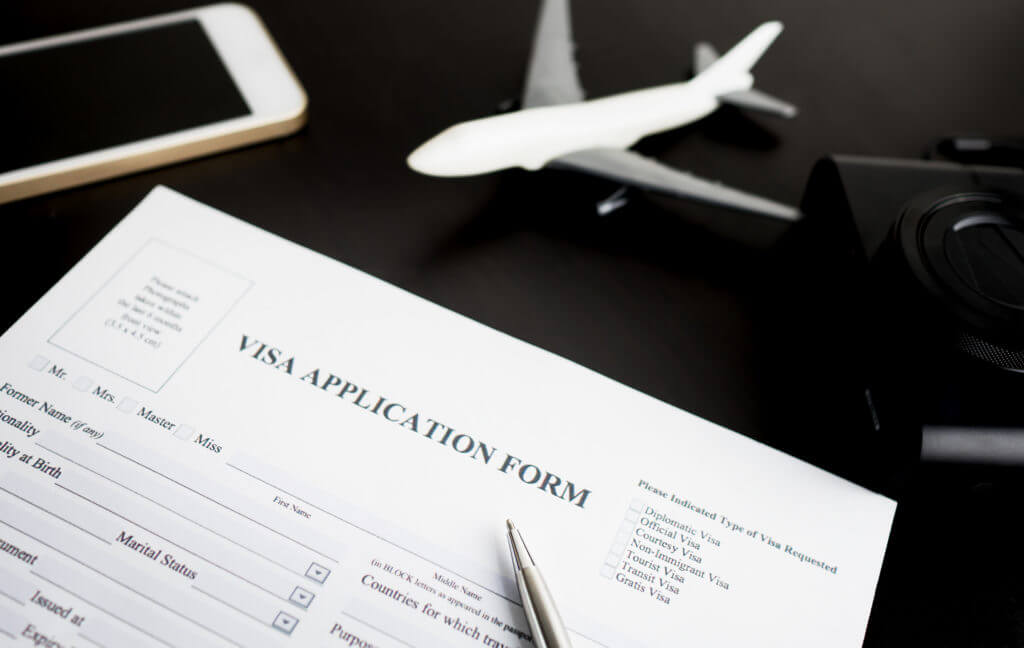 Filling travel Visa application form for vacation