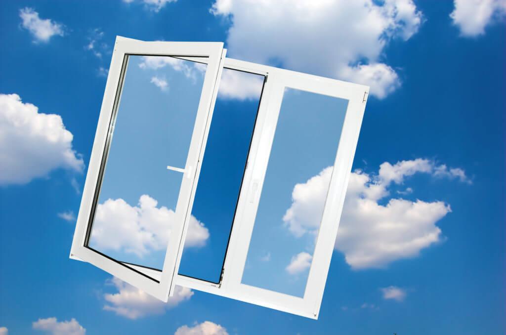 Opened window on blue sky background.